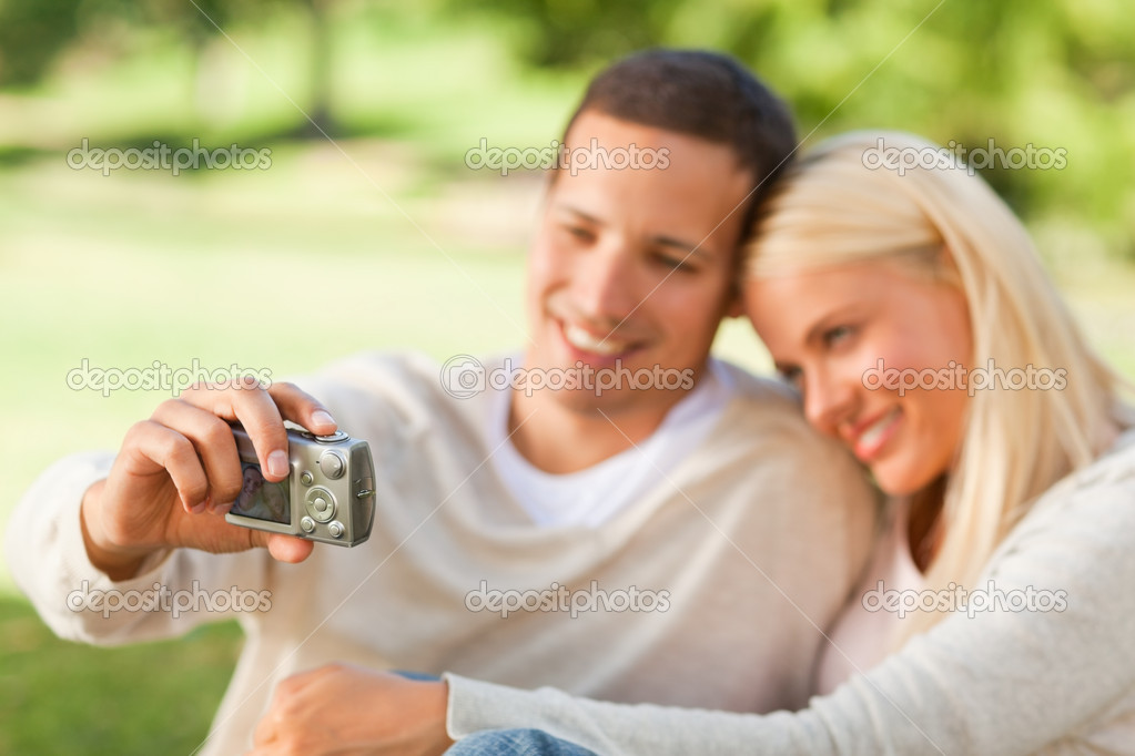 Young couple taking a photo of themselves — Stock Photo #10857460