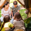 Happy family camping in the park — Stock Photo #10860045