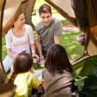 Happy family camping in the park — Stock Photo #10860049