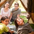 Happy family camping in the park — Stockfoto