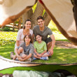 Joyful family camping in the park - Stok fotoğraf