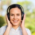 Beautiful woman listening to music — Stock Photo