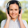 Stock Photo: Beautiful womlistening to music