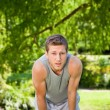 Sporty handsome man in the park - Stock Photo