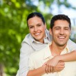 Man giving wife a piggyback — Stockfoto