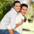 Man giving wife a piggyback — Stock Photo #10860283