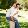 Man giving wife a piggyback — Stock Photo #10860286
