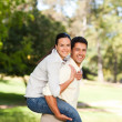 Man giving wife a piggyback — Stock Photo #10860289