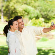 Young couple taking a photo of themselve — Stock Photo