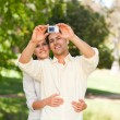 Stock Photo: Couple taking a photo of themselve
