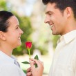 Happy man offering a rose to his girlfriend — Stock Photo #10860373
