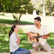 Man playing guitar for his girlfriend — Stock Photo #10860386