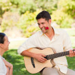 Handsome man playing guitar - Stock Photo
