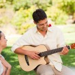 Stock Photo: Handsome man playing guitar