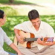 Romantic man playing guitar for his wife - Foto Stock