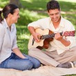 Romantic mplaying guitar for his wife — Foto de stock #10860412