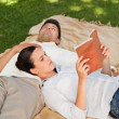Couple reading in the park — Stock Photo #10860422