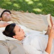 Couple reading in the park — Stock Photo #10860428