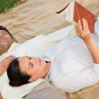 Couple reading in the park — Stock Photo #10860430
