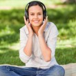 Happy young woman listening to music — Stock Photo #10860600