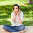 Happy young woman listening to music — Stock Photo #10860608