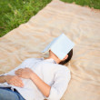 Stock Photo: Womsleeping with her book