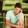 Royalty-Free Stock Photo: Young handsome man phoning