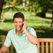 Stock Photo: Young handsome man phoning