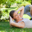 Stock Photo: Couple doing their stretches in park