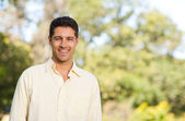 Handsome man in the park — Stock Photo