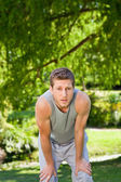 Sporty handsome man in the park — Stock Photo