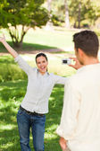 Man taking a photo of his girlfriend — Stock Photo