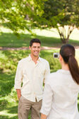 Woman taking a photo of her boyfriend — Stock Photo