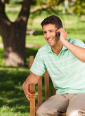 Young handsome man phoning — Stok fotoğraf
