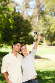 Couple taking a photo of themselve — Stock Photo