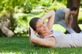 Couple doing their stretches in the park — Foto de Stock