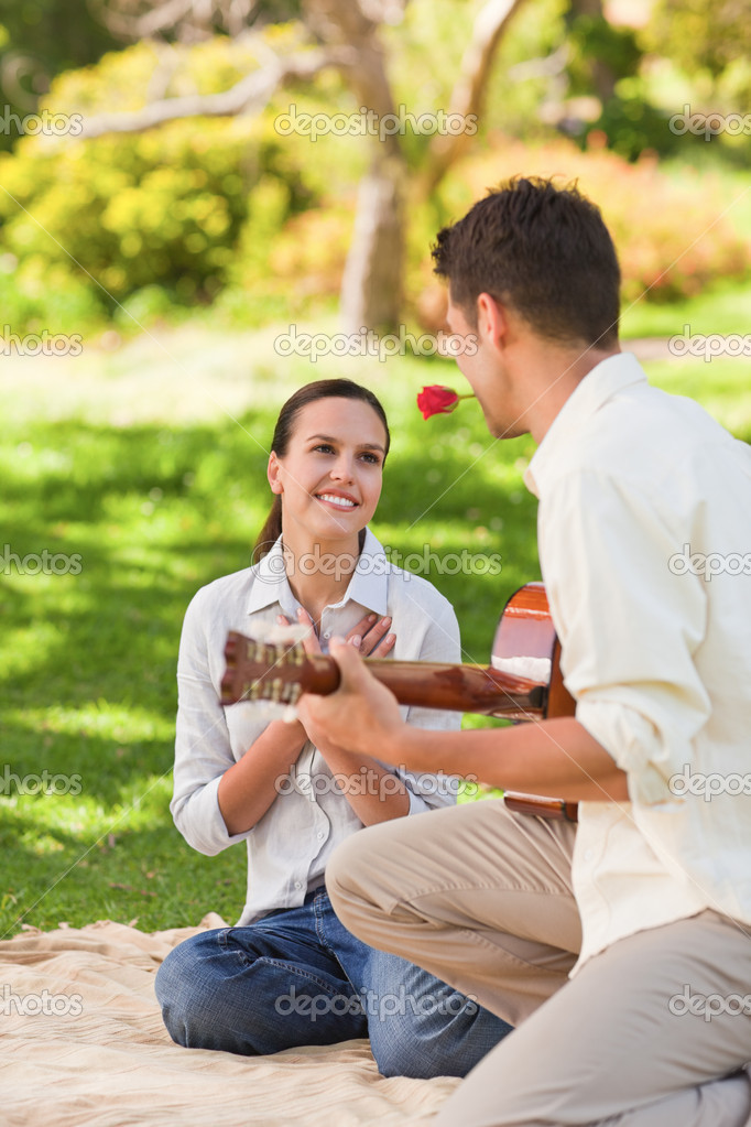 Handsome man playing guitar — Stock Photo #10860396