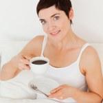 Cute woman drinking coffee — Stock Photo