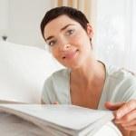 Cute woman reading a magazine — Stock Photo