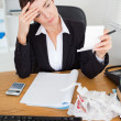 Stock Photo: Portrait of serious accountant checking receipts