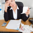 Stock Photo: Portrait of female accountant checking receipts