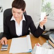 Stock Photo: Portrait of active accountant checking receipts