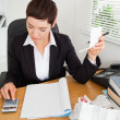 Portrait of an active accountant checking receipts - Stockfoto