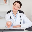 Female doctor showing pills — Stock Photo #11178829