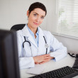 Serious female doctor looking at the camera — Stock Photo #11178844