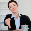 Portrait of a smiling business woman giving her hand — Stock Photo
