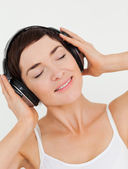 Portrait of a charming brunette listening to music — Stock Photo