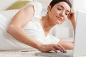 Close up of a quiet woman relaxing with a laptop — Stock Photo