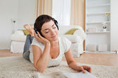 Cute woman with a magazine enjoying some music — Stok fotoğraf