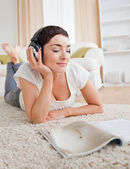 Portrait of a cute woman reading a magazine while enjoying some — Stock Photo